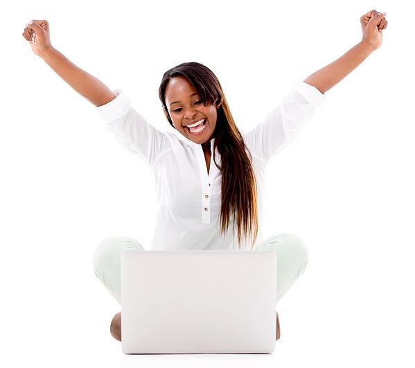 Very excited woman with a laptop and arms up - isolated over white