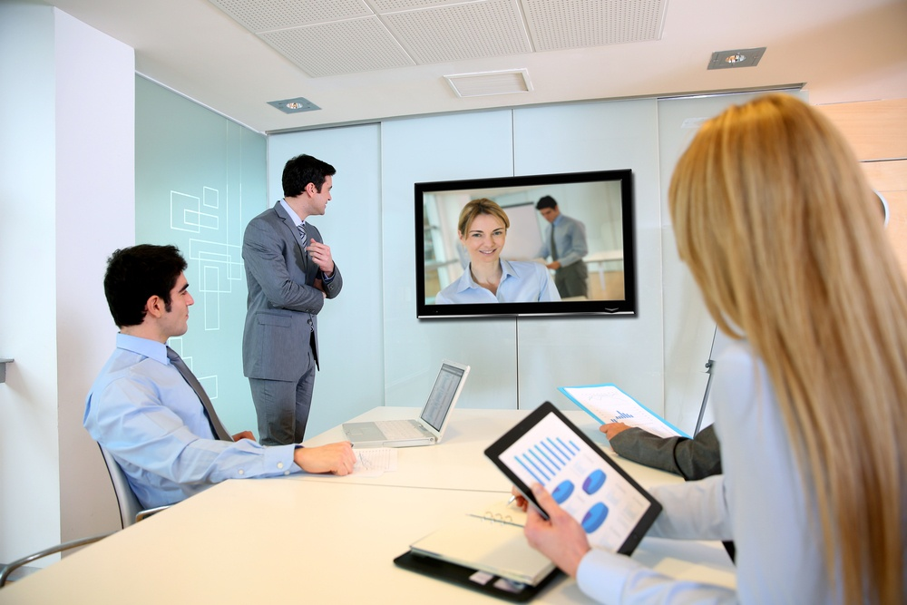 Business people attending videoconference meeting